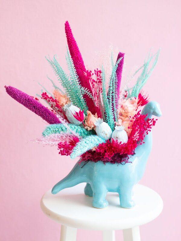 Dino, centro de flores secas y preservadas dinosaurio | Loreak